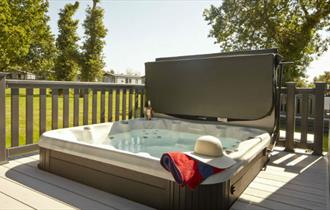 Hot tub on balcony of lodge at St Helens Coastal Resort, Isle of Wight, Self Catering