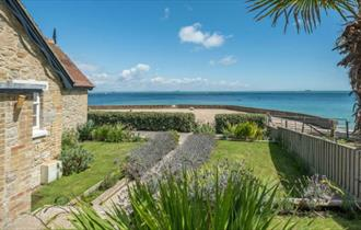 Side view of house and front garden with seaview - self-catering, Isle of Wight, HB Holiday Lettings