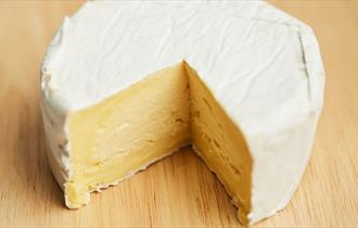 Image of a round of isle of wight soft cheese with a slice missing, Isle of Wight Cheese CO, Local produce, Sandown