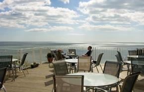 Outside deck with dining table and chairs at The Wellington Hotel, Ventnor