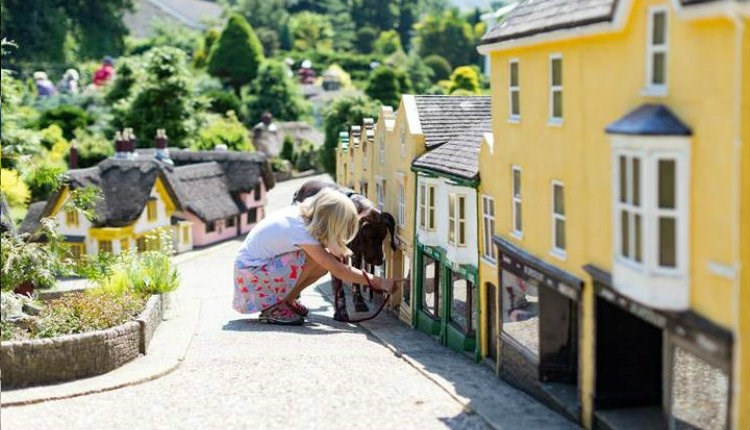 Child viewing the Old Shanklin Village miniature at the Godshill Model Village, Isle of Wight, Things to Do