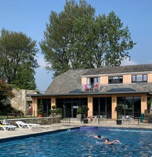 Outside view of The Core Complex overlooking the swimming pool at Appuldurcombe Gardens Holiday Park, Isle of Wight