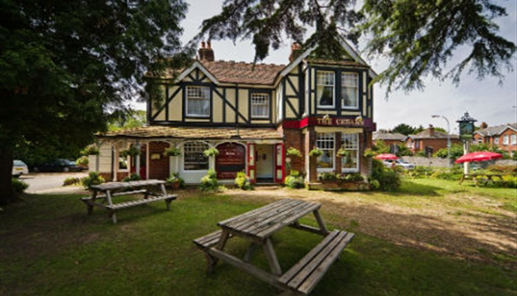 Outside view of The Cedars with seating area, Wootton, pub