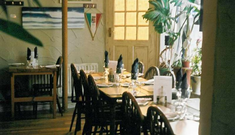 Tables and chairs inside of Toninos Italian Restaurant, Cowes, eat and drink