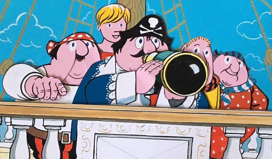 Cartoon of Captain Pugwash and his friends on a pirate ship.