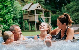 Family enjoying hot tub at Ribby Hall Village