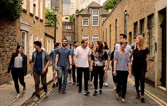 A dozen performers walk through the streets of Lancaster city.  Image credit Eliza Brown