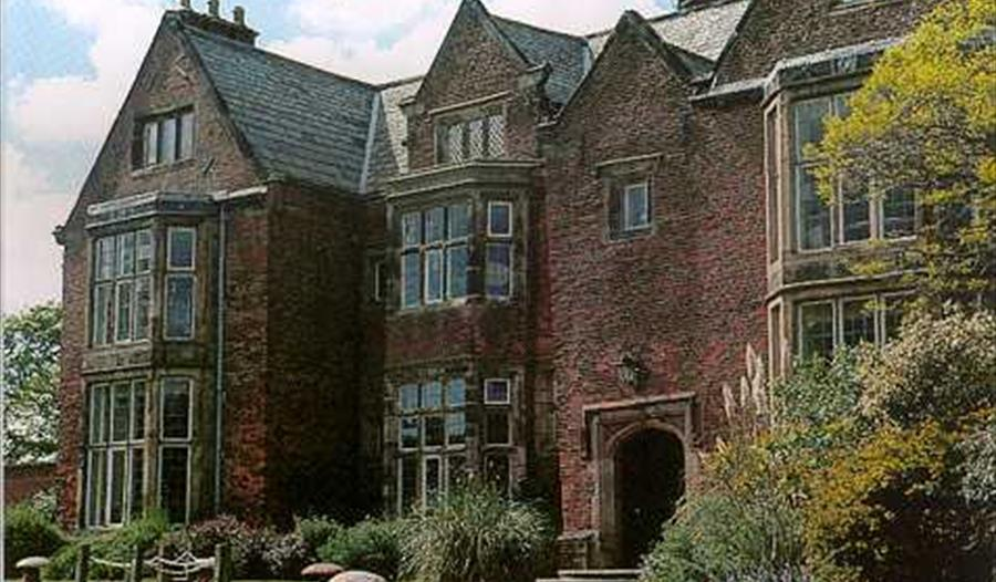 Outdoor picture of Heskin Hall, off its driveway.