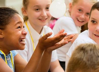 Children watch an experiment in fascination.