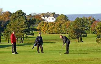 Playing golf at Morecambe Golf Course