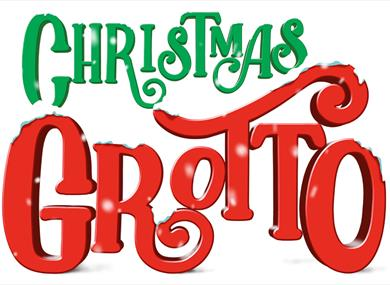 Christmas grotto logo in green and red with snow falling on the words.