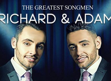 Promotional poster of the show, with the two performers smiling at the camera.