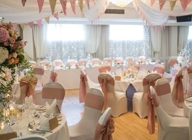 Dining room dressed for a wedding