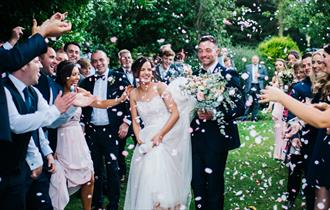 Couple celebrating with friends at Shireburn Arms