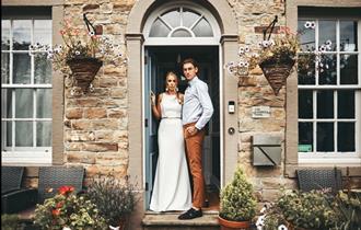 Happy couple at the front door