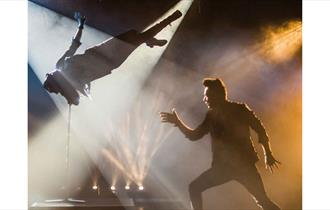 Dramatic image of the performance in the spotlight of the theatre.