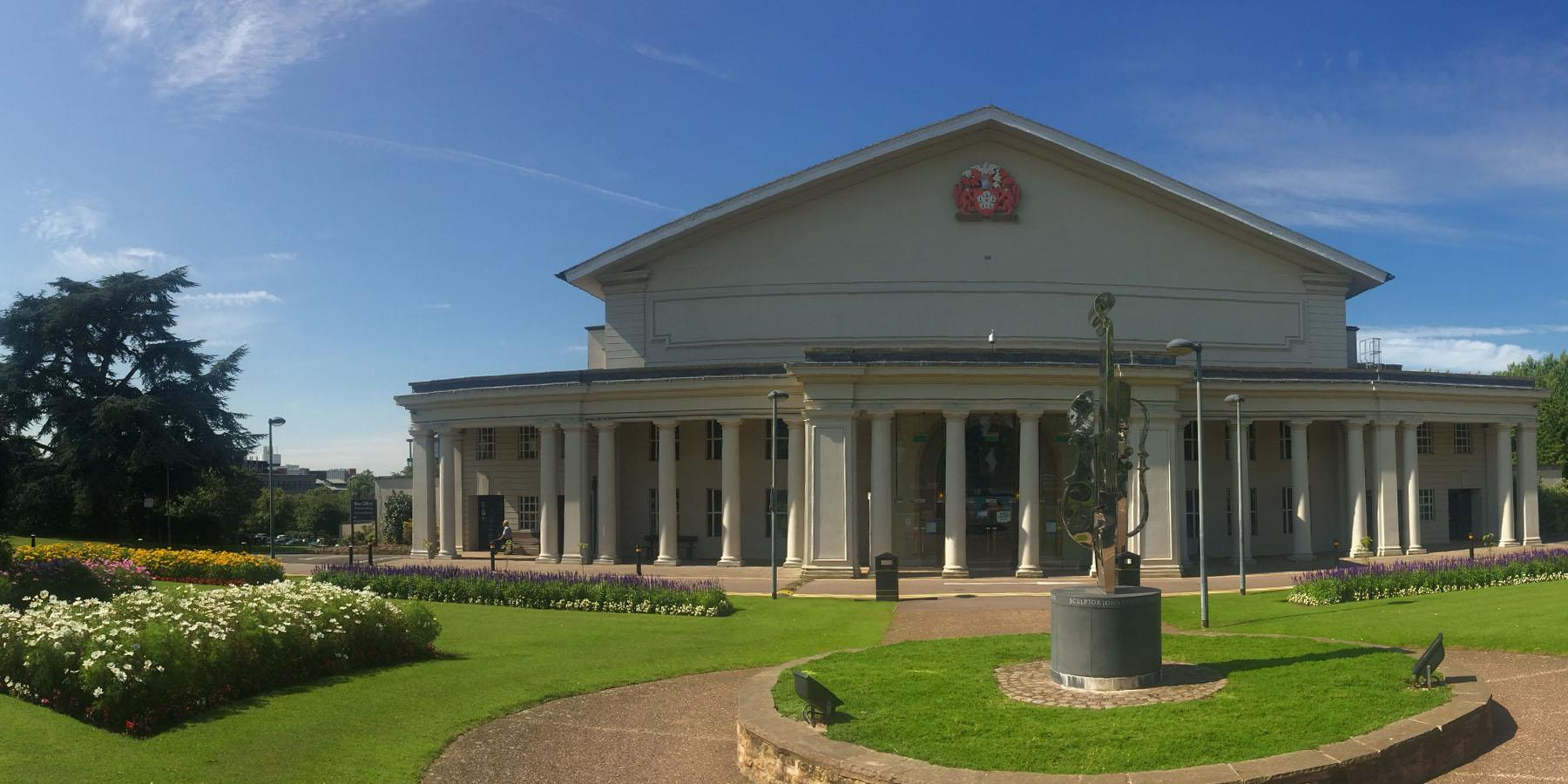 de montfort hall exterior with blue sky