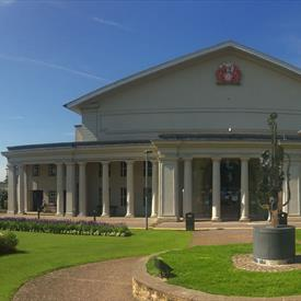 de montfort hall exterior with blue sky