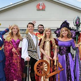 A group of people in bright costumes