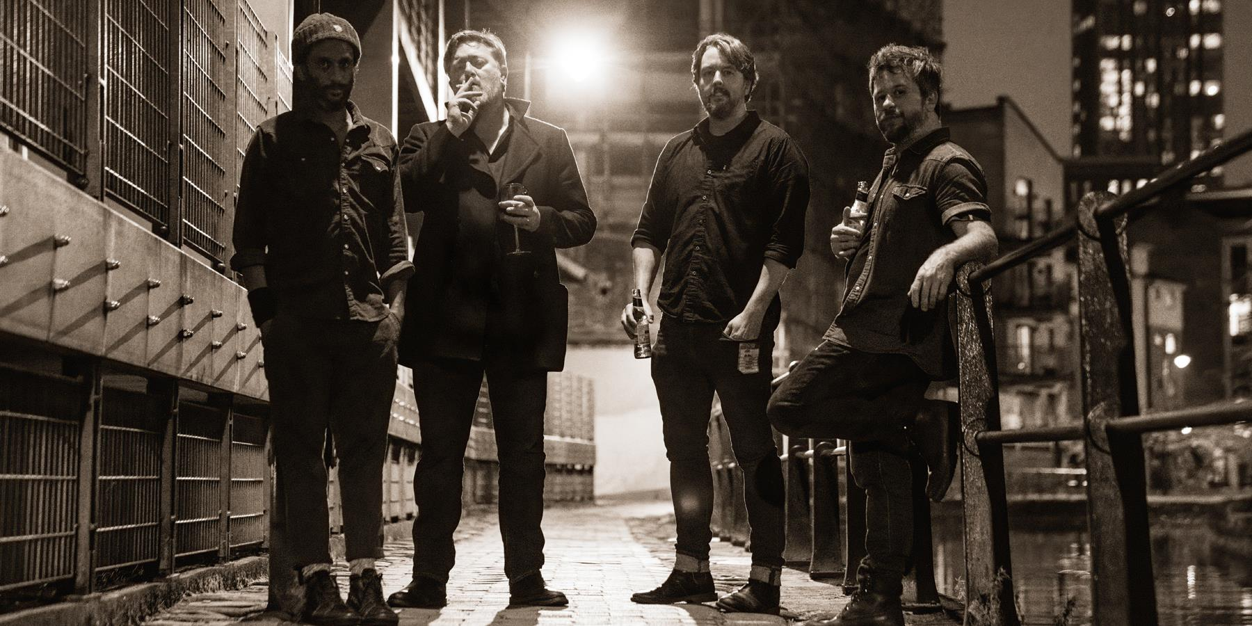 A band standing in an alleyway