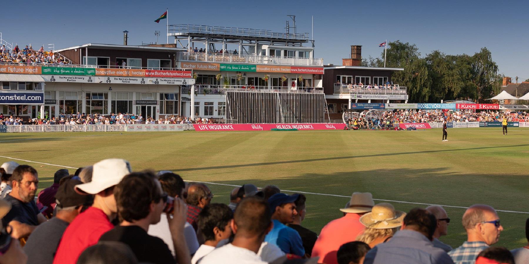 Crowd watching cricket match