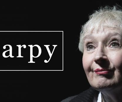 Image of a woman on a black background with the wording HARPY