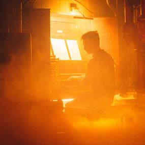 A man sat playing at an organ