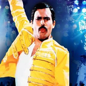 A man dressed as Freddie Mercury in a yellow jacket