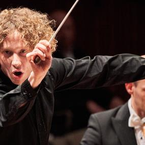 A conductor with his baton