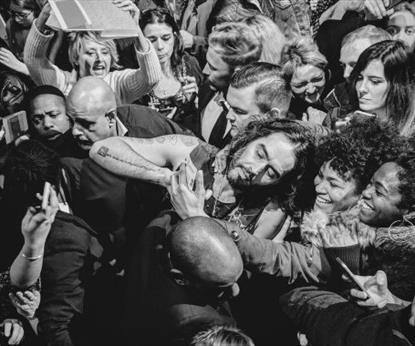 A man surrounded by  crowd