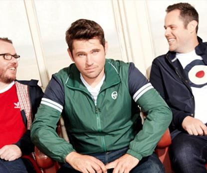 Three men sitting on a sofa
