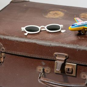 Image of suitcase with sunglasses