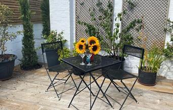 Garden terrace with sunflowers