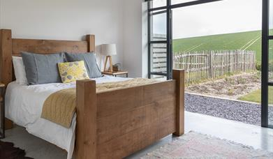 Bedroom with doors to the terrace