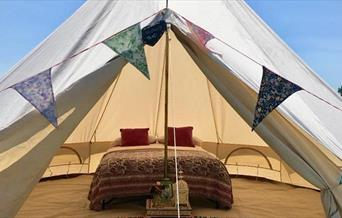 Glamping tent with buting