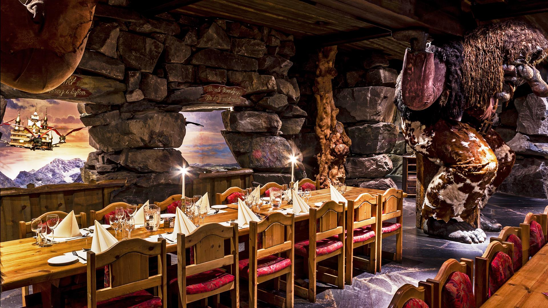 Dining tables at Trollsalen Restaurant at Hunderfossen Eventyrpark where the trolls are holding the celling up on their shoulders