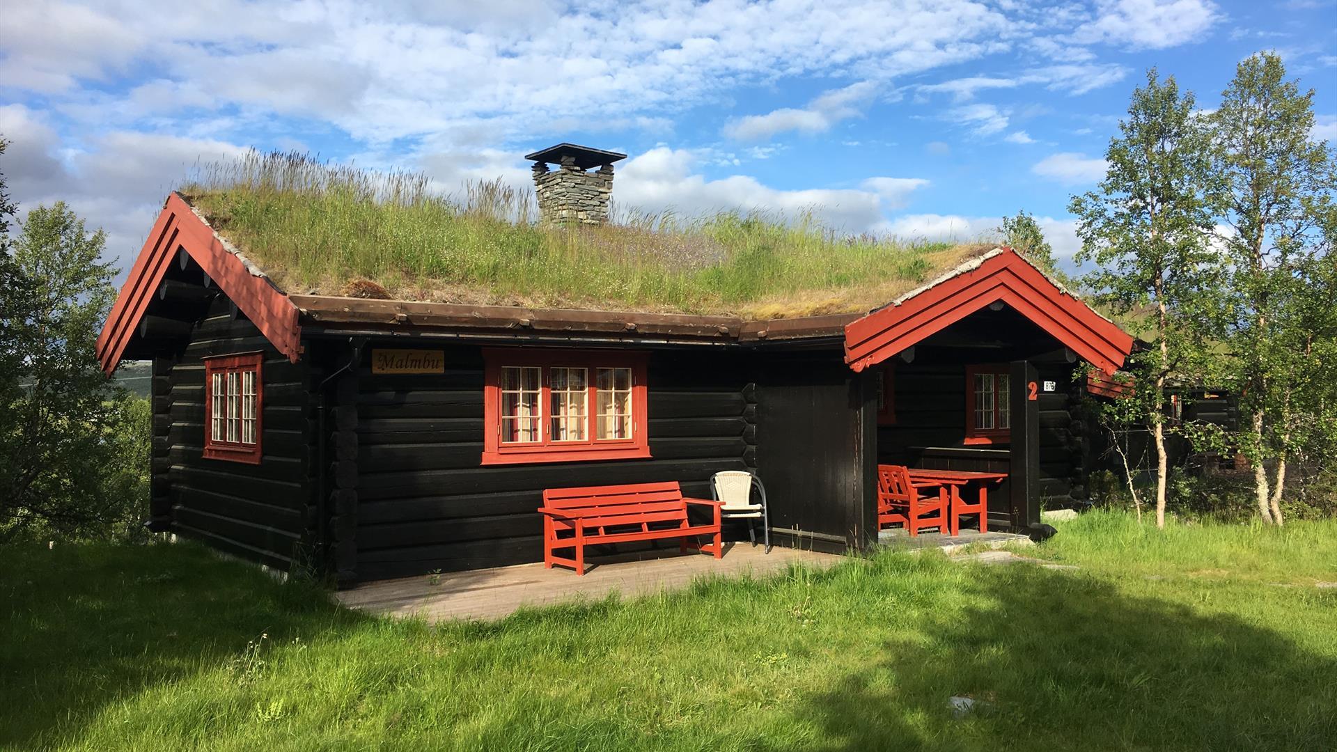 Malmbu, a traditional turf-roofed cabin. Venabu Hytter