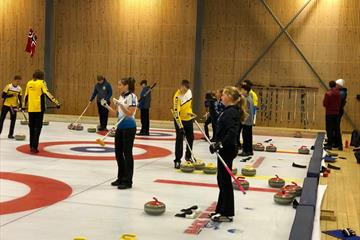 Several teams playing curling