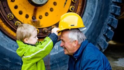 Boy put his helmet on grandfather - Norwegian Rock Blasting Museum Hunderfossen
