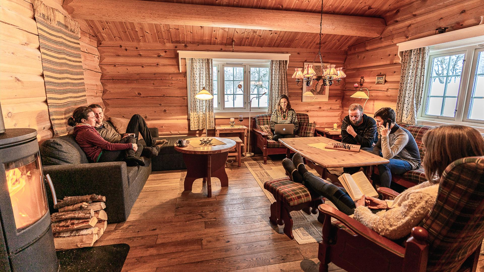 A group of friends sit in a cabin lounge