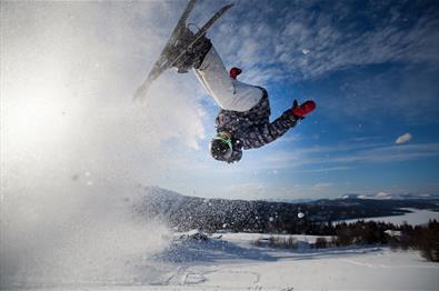 Jumping with skiis in Gålå Alpine Centre