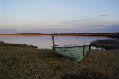 Smal boat by a mountain lake