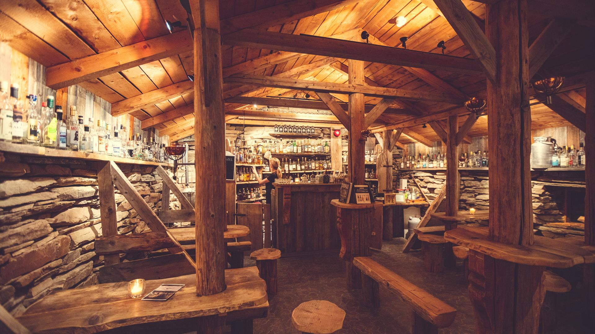 An old barn is made into a bar where we serve over 100 differend types of aquavit. Spidsbergseter Resort Rondane.