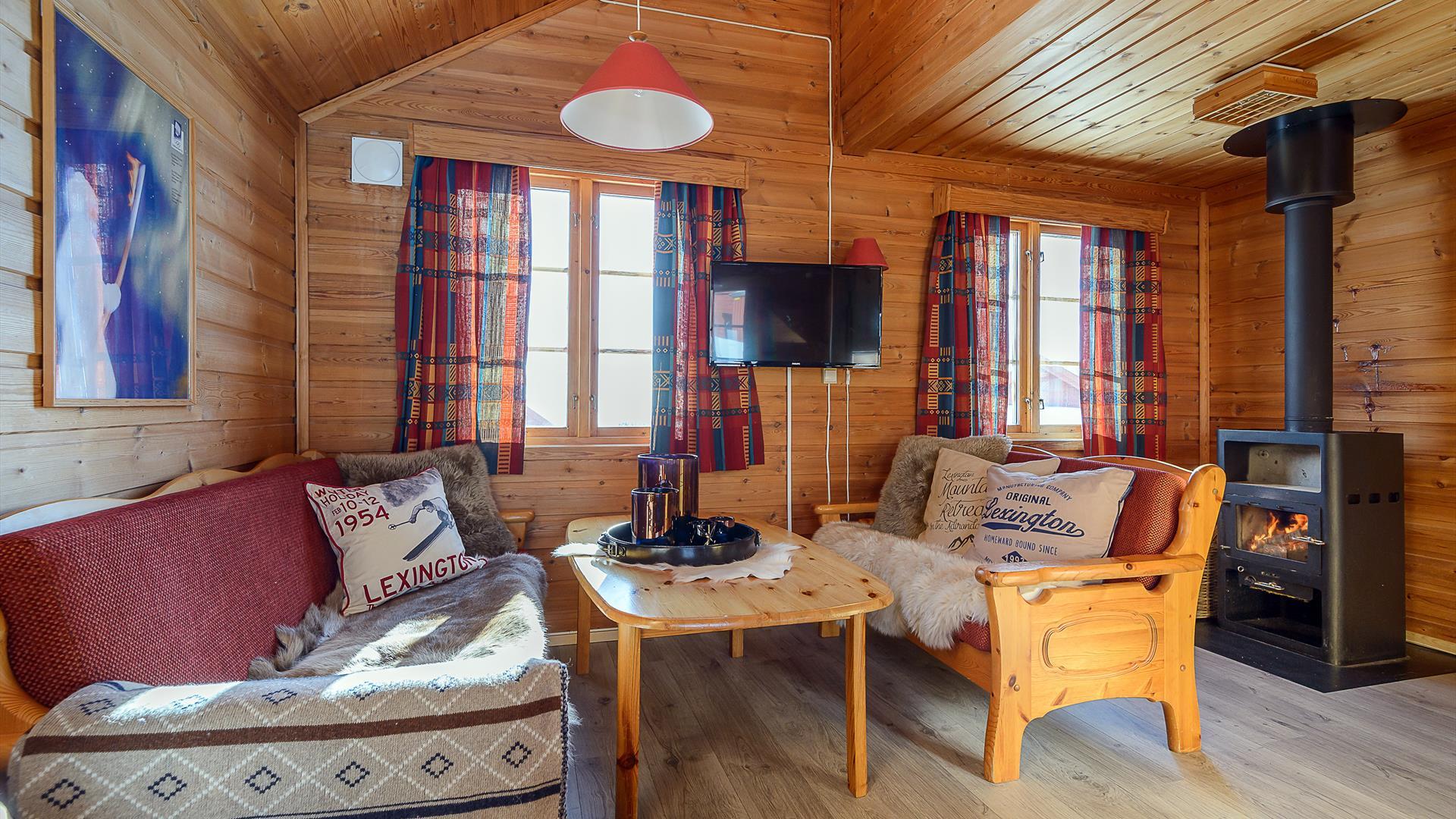 Liten peisestue i hyttene til Nordseter Hytter
