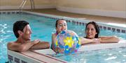 Family relaxing in the pool at Tregoad Holiday Park