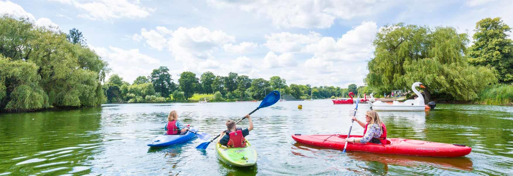 Family canoeing on lake at Mote Park