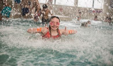 Girl enjoying swimming pool