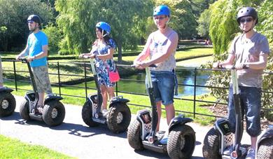A group of people on Segways