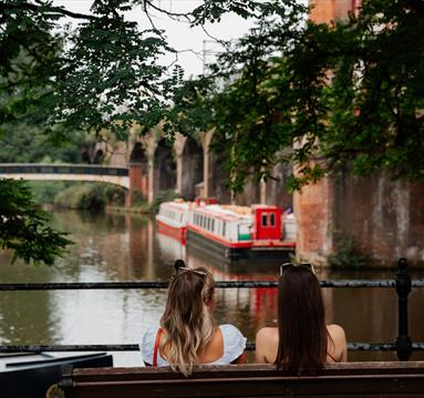 2 females looking out to the canal