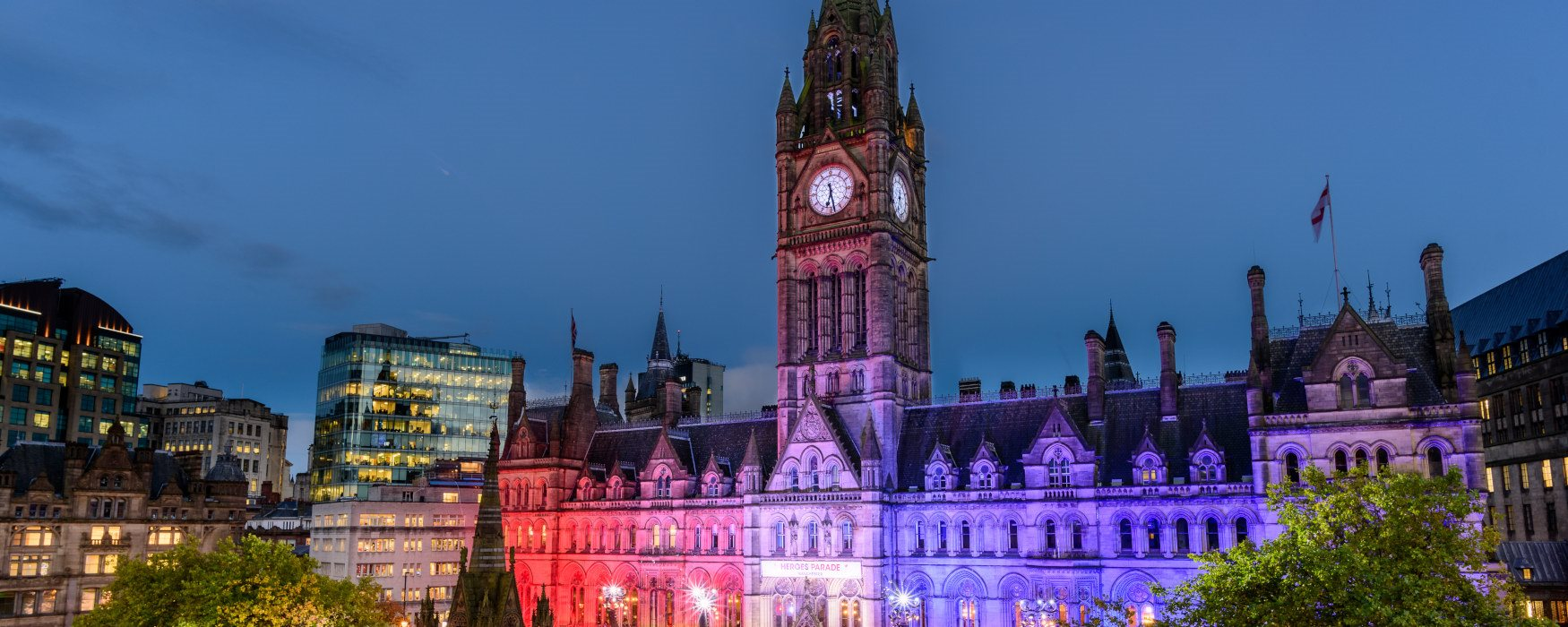 Manchester Town Hall lit up at night